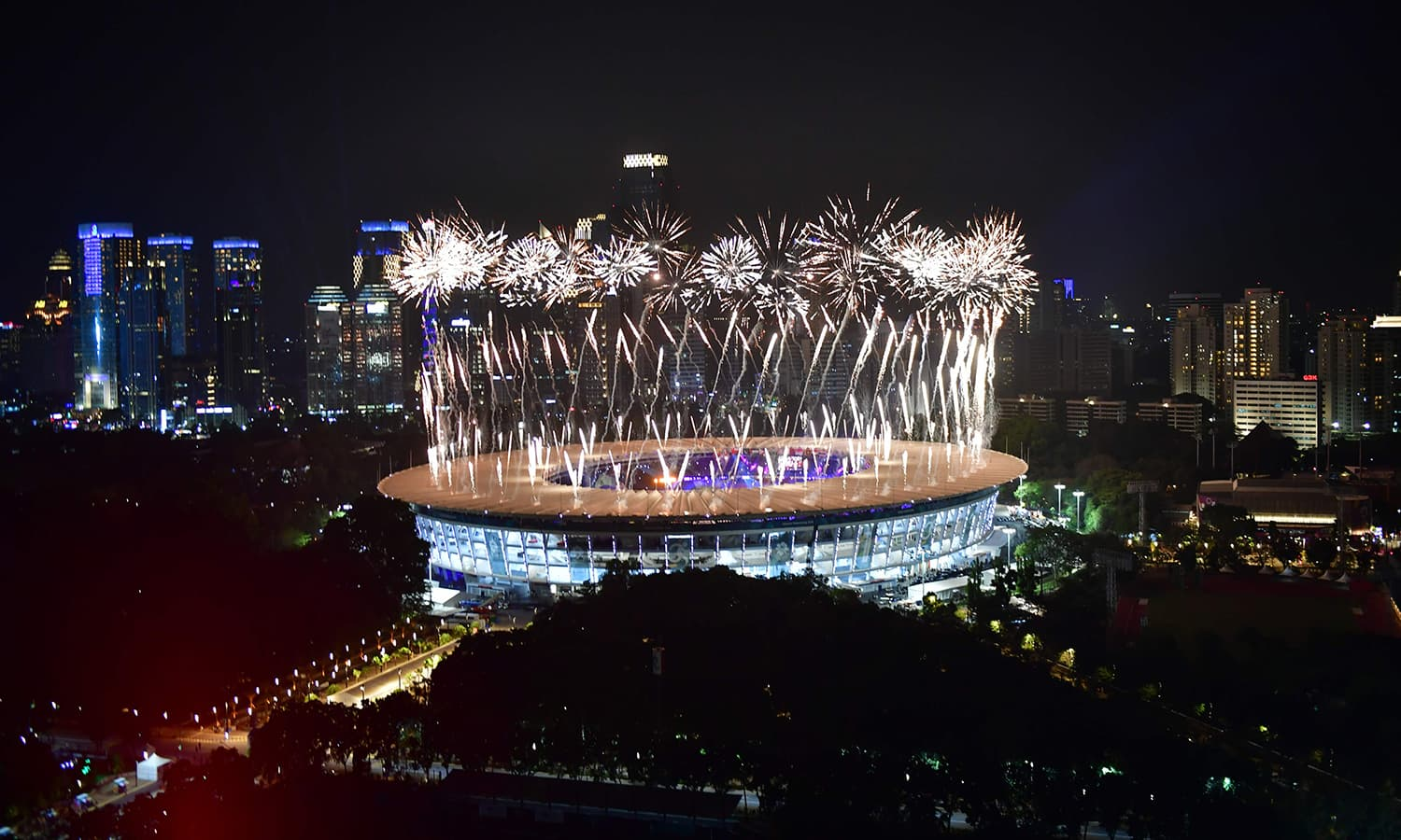 Fireworks explode over the Gelora Bung Karno main stadium during the opening ceremony. —AFP