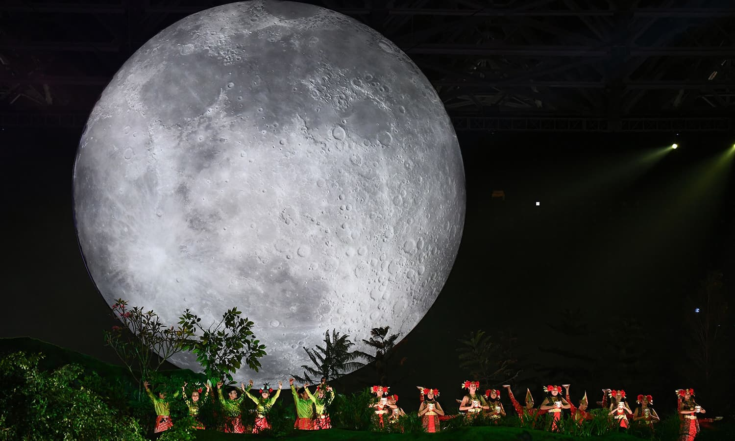 Actors give a stirring performance during the opening ceremony of the 2018 Asian Games. —AFP