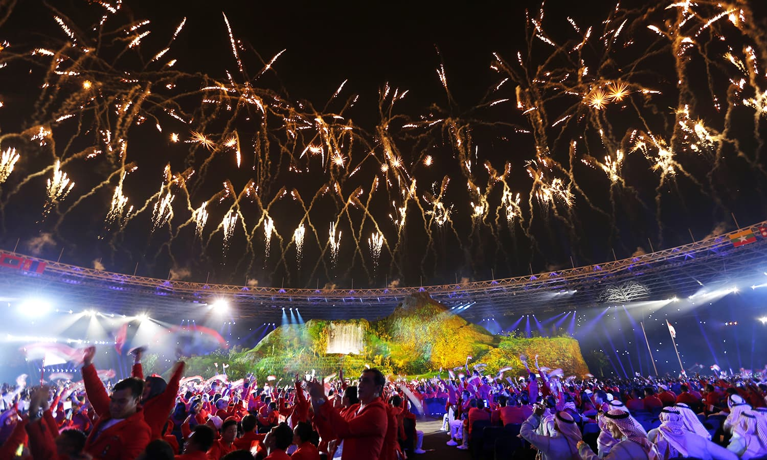 Athletes applause as firewors explode during the opening ceremony. —AP
