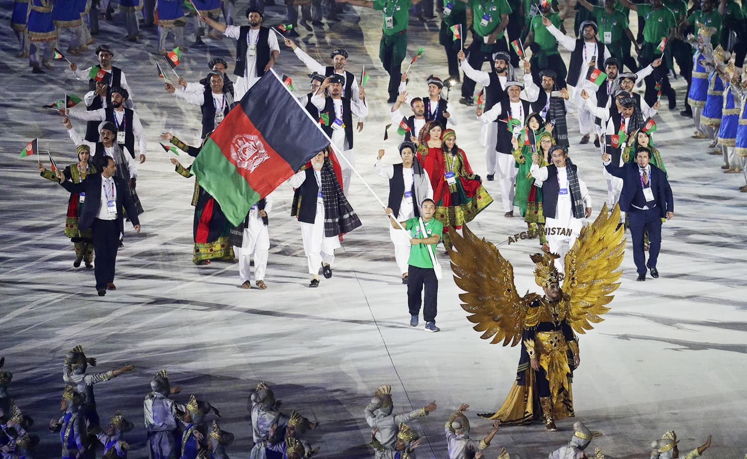 The Afghanistan team marches in during the opening ceremony. —AP