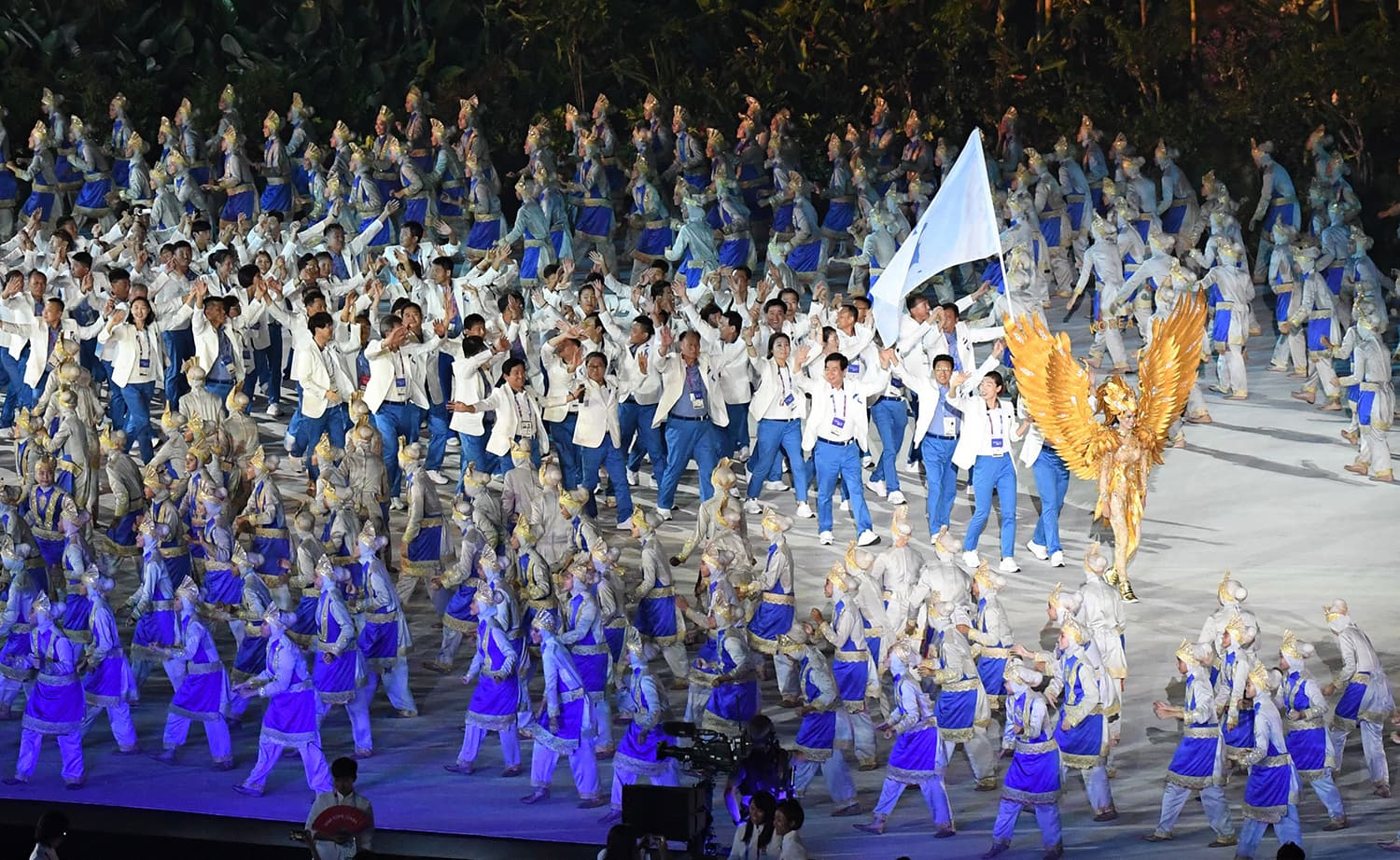 The Unified Korea delegation parades during the opening ceremony of the 2018 Asian Games. —AFP