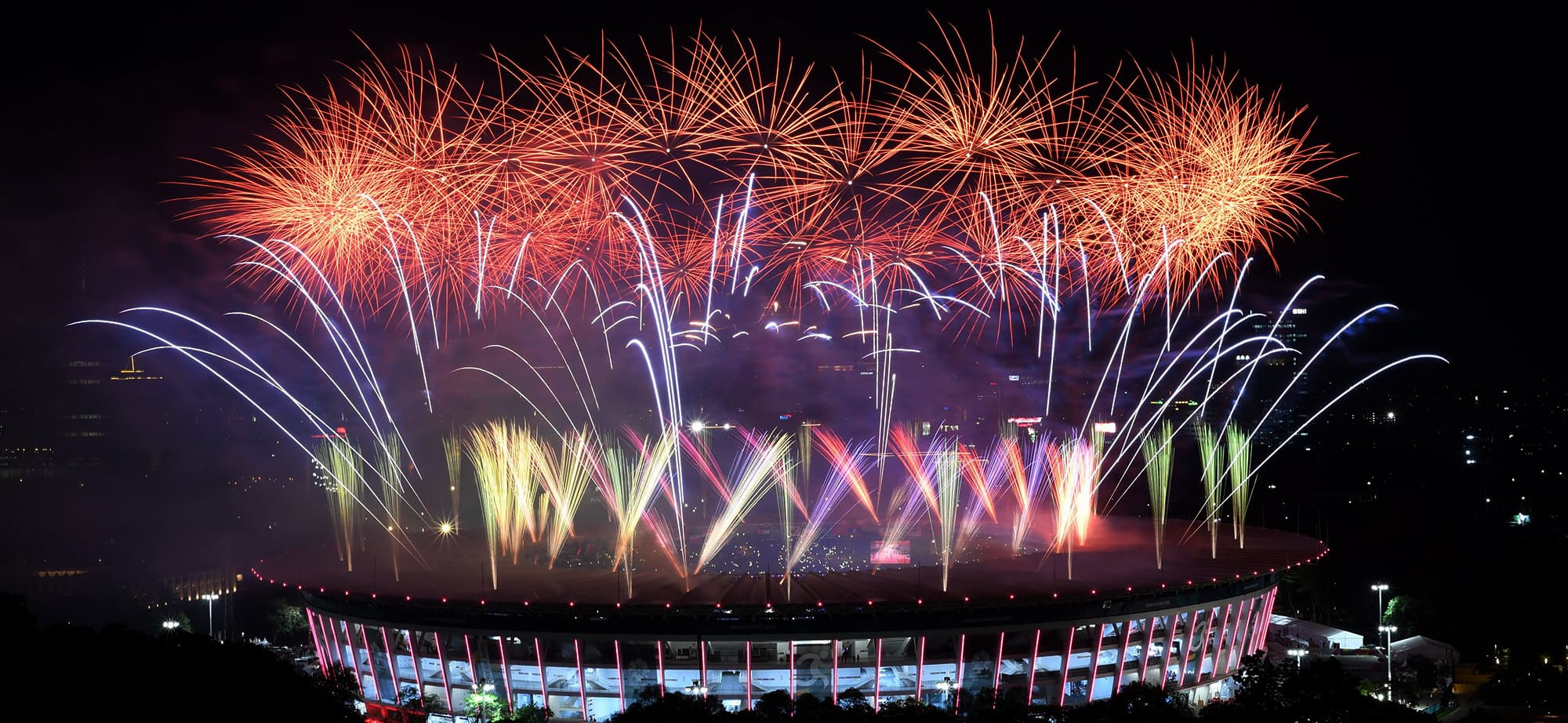 Fireworks explode over the Gelora Bung Karno main stadium during the opening ceremony of the 2018 Asian Games in Jakarta on August 18, 2018. (Photo by Arief Bagus / AFP) — AFP or licensors