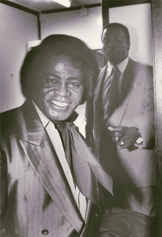A 1988 backstage photo of James Brown with his bodyguard shadowing him