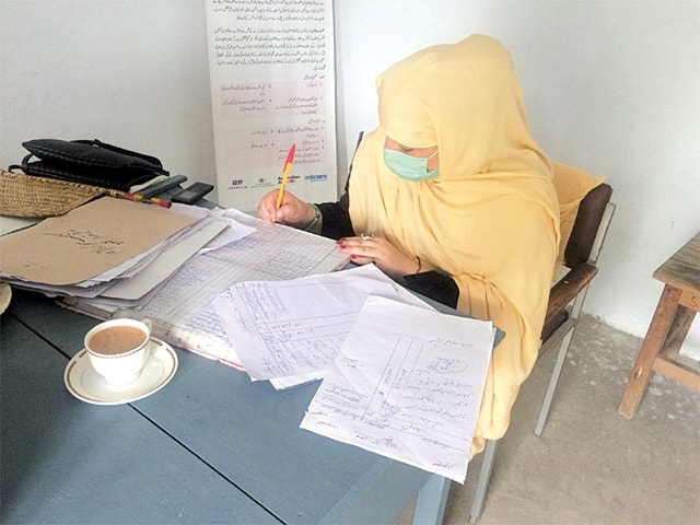 REHMAT Jahan, Dir's first-ever woman police moharrir at work in her office at the Balambat police station in Timergarha, Lower Dir.—Photo by writer