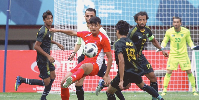 CIKARANG: Pakistan and Nepal players vie for the ball during their Asian Games Group 'D' match at the Patriot Chandrabhaga Stadium on Sunday.—Courtesy AFC