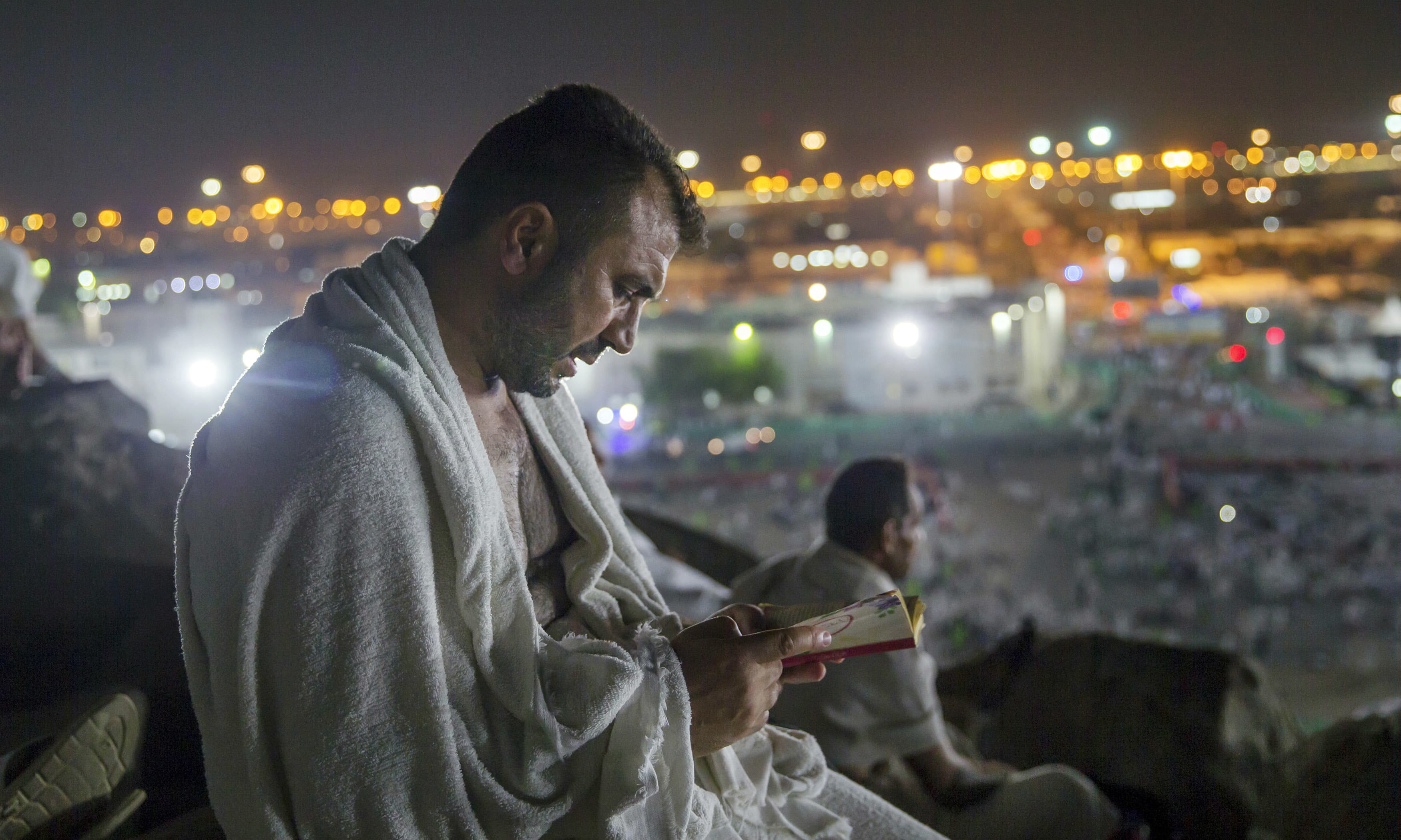 A pilgrim prays at Jabal Al Rahma, or the mountain of forgiveness, at Arafat for the annual Haj pilgrimage. —AP