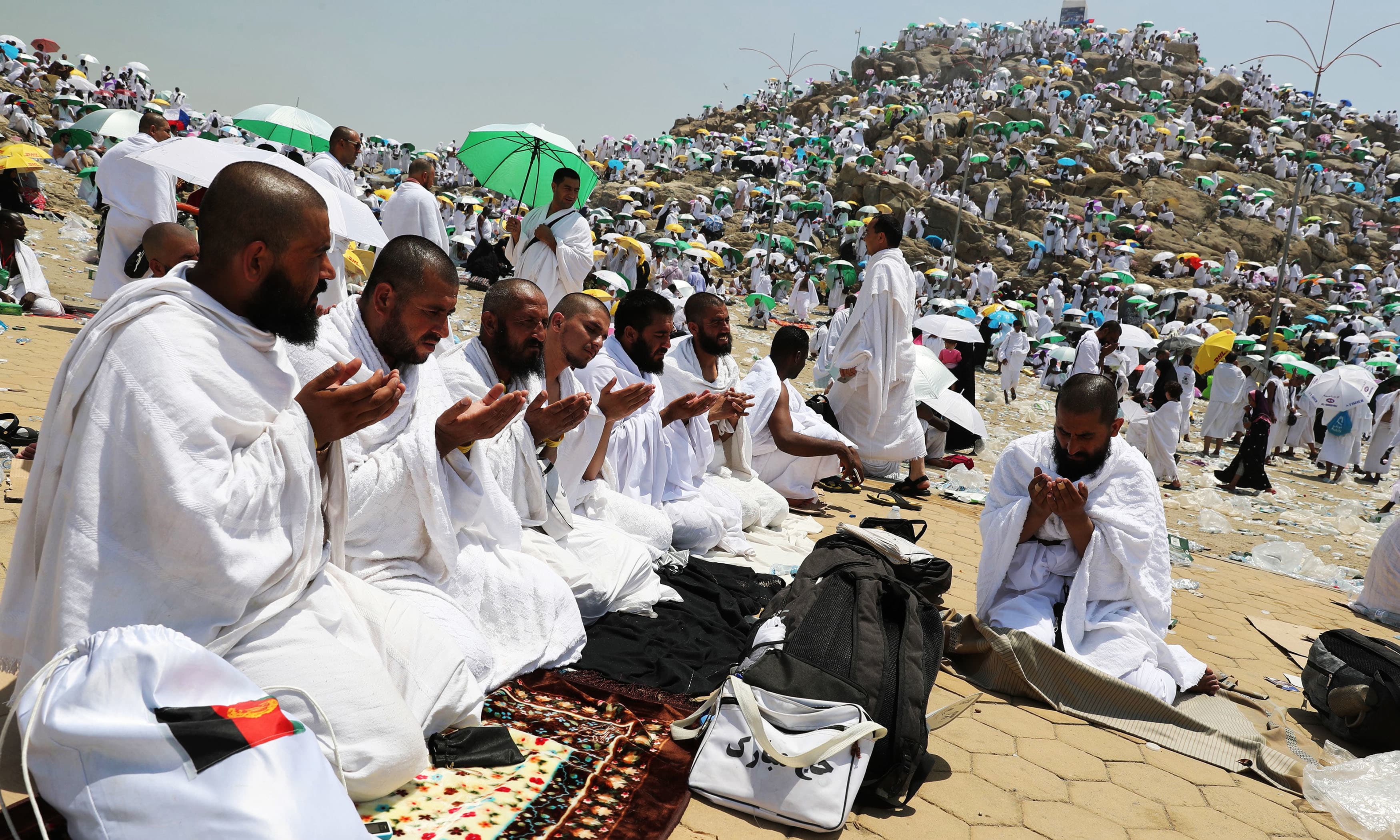 Pilgrims pray at Mount Arafat, also known as Jabal al-Rahma (Mount of Mercy). —AFP