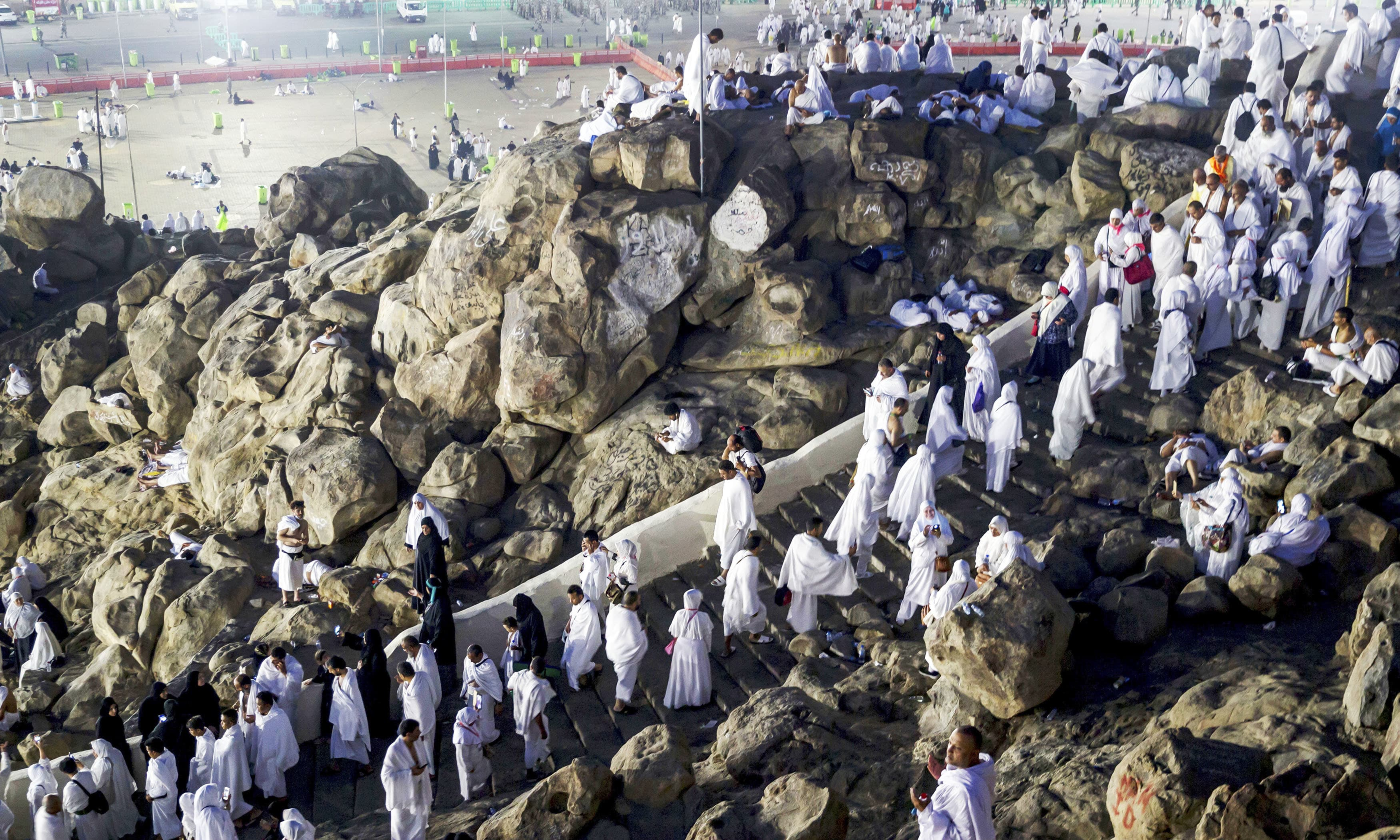 Pilgrims visit the Jabal Al Rahma holy mountain, or the mountain of forgiveness, upon their arrival to Arafat for the annual Haj pilgrimage. —AP
