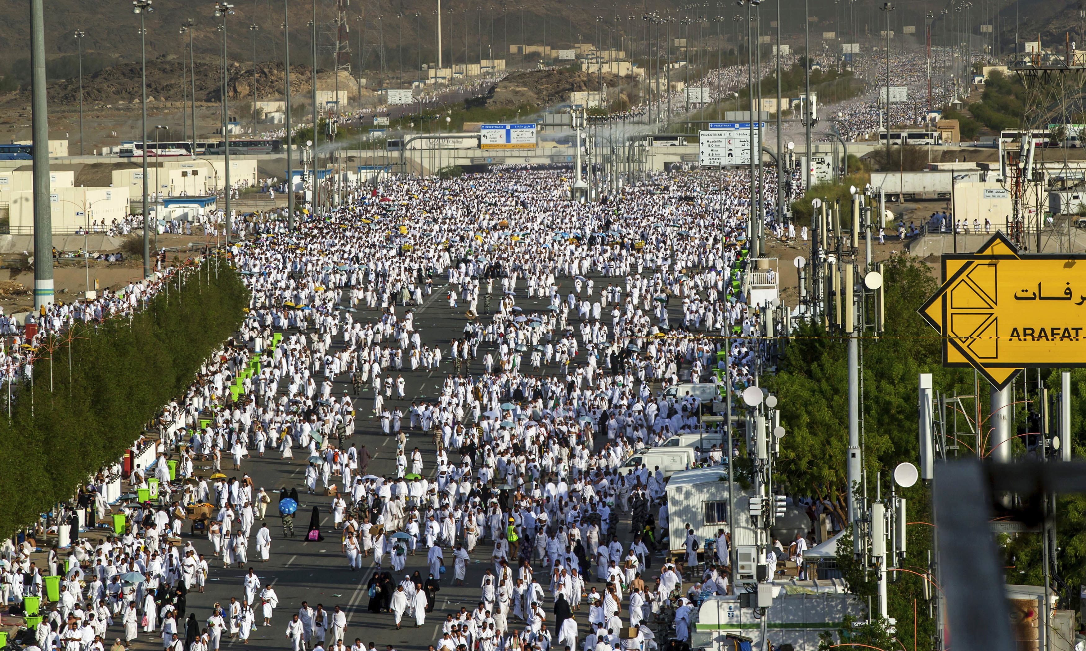 Pilgrims walk towards the Namirah mosque on Arafat Mountain during the annual Haj pilgrimage. —AFP