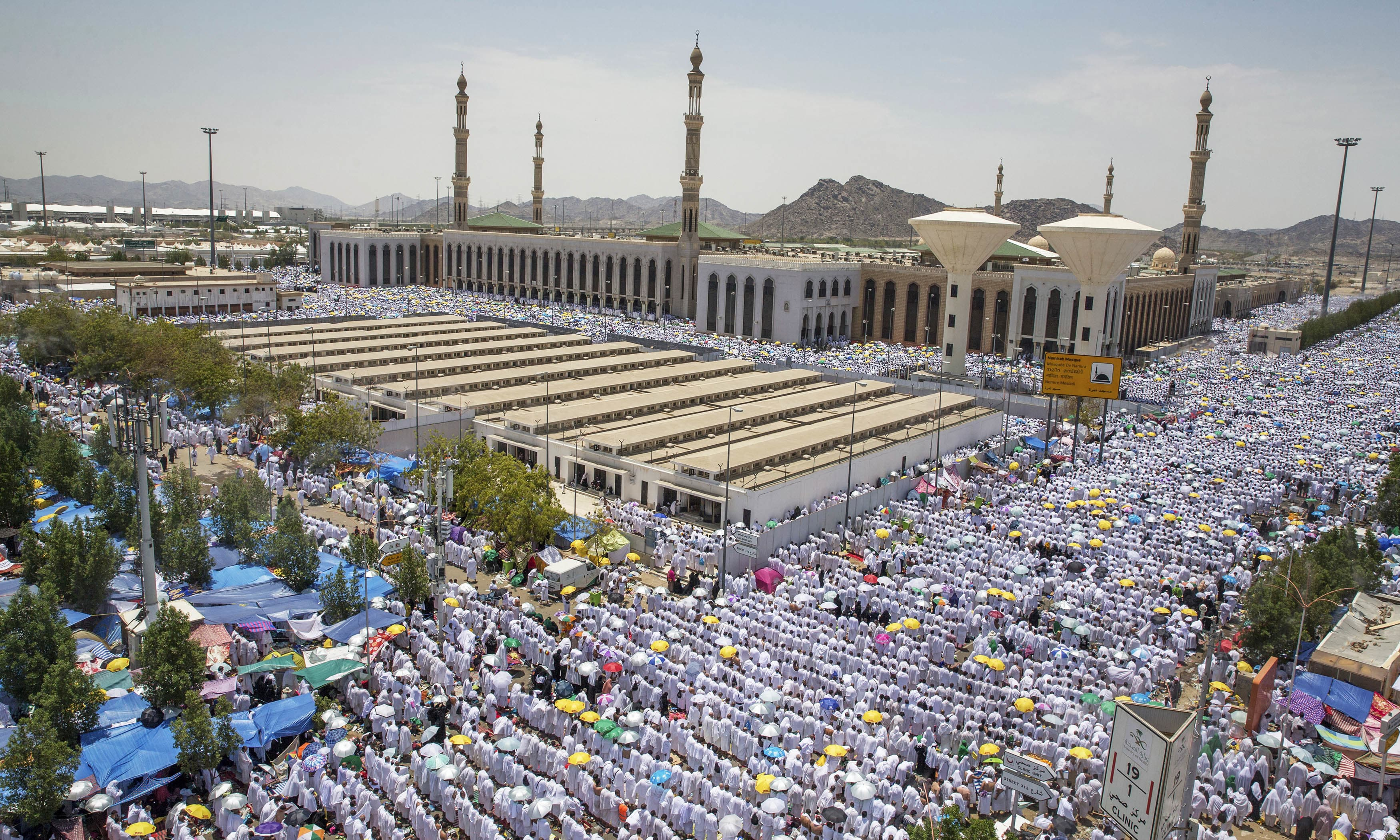 Pilgrims attend noon prayers outside the Namirah mosque on Arafat Mountain. —AFP