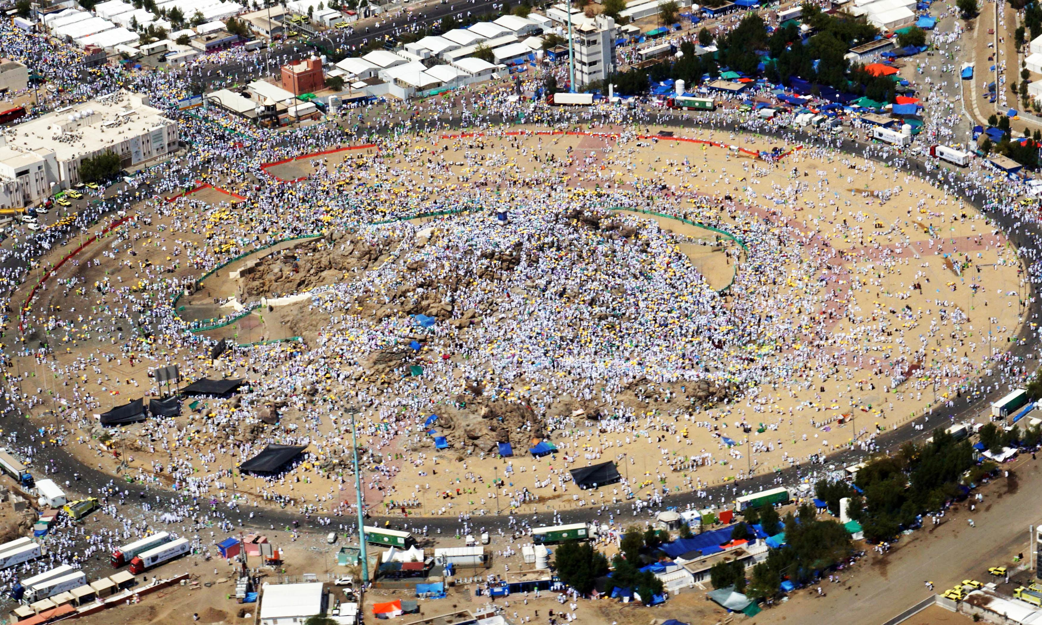 An aerial view shows pilgrims praying at Mount Arafat, also known as Jabal al-Rahma (Mount of Mercy). —AFP