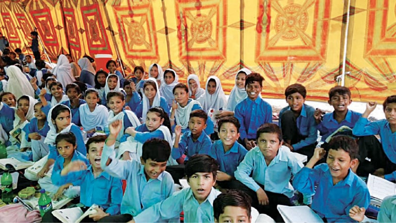 TOBA TEK SINGH: Students studying in a tent. — Dawn