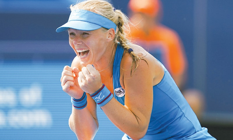 KIKI Bertens of the Netherlands celebrates after defeating Romania's Simona Halep in the final.—AP