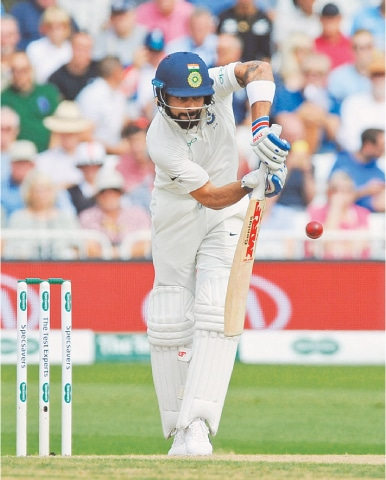 INDIAN captain Virat Kohli offers a defensive bat during the third day of the third Test against England at Trent Bridge.—AP