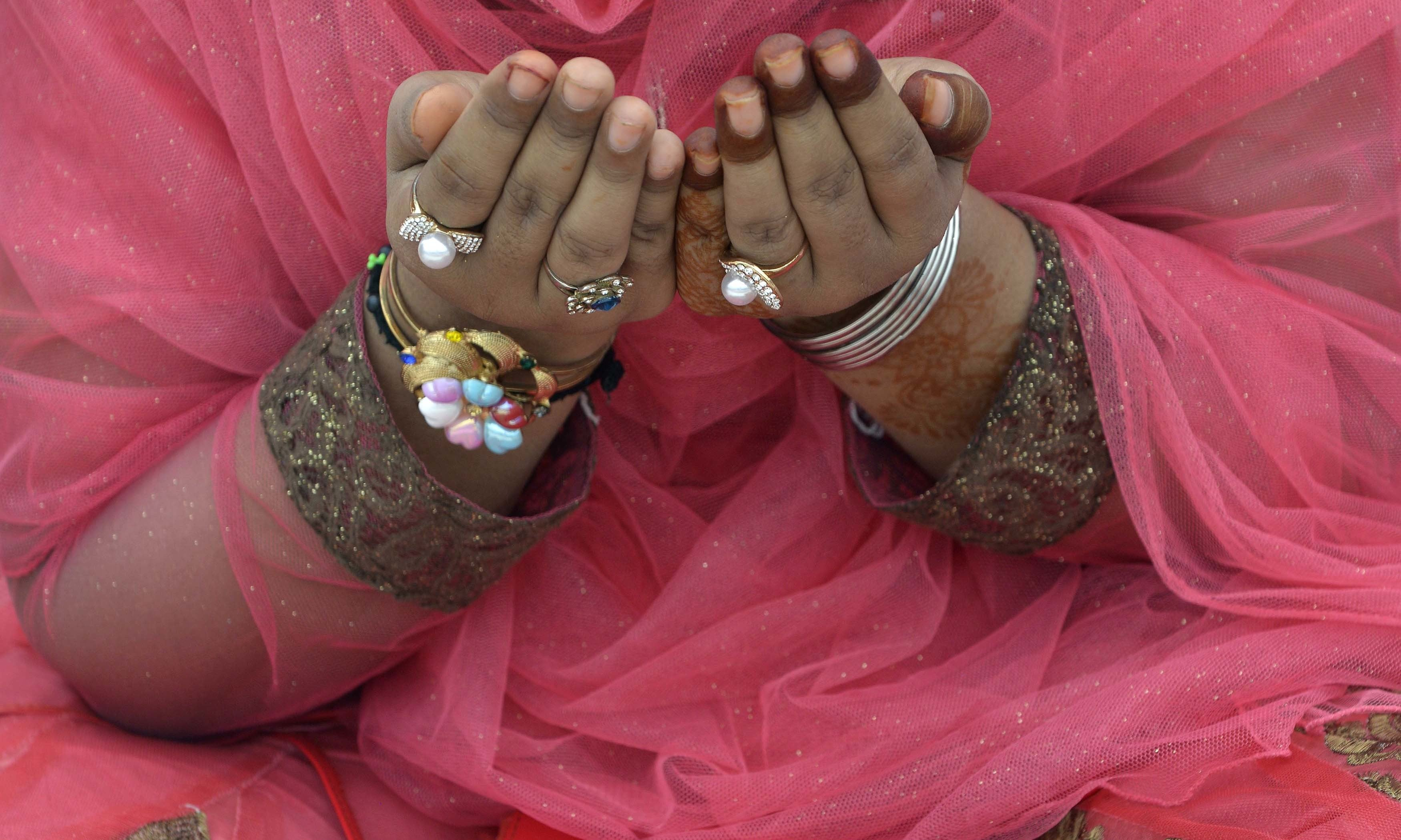 A woman offers Eidul Azha prayers at the Badshahi Mosque in Lahore. — AFP