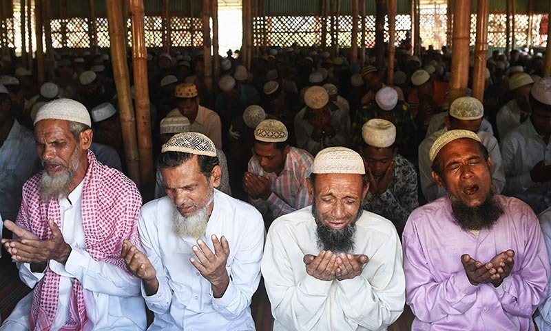 Rohingya refugees offer Eidul Azha prayers at the Jamtoli refugee camp in Ukhia district near Cox's Bazar — AFP