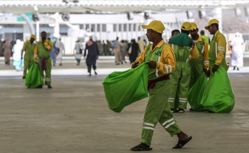 Sanitation workers collect litter during the annual Haj pilgrimage in Makkah on Wednesday. — AFP