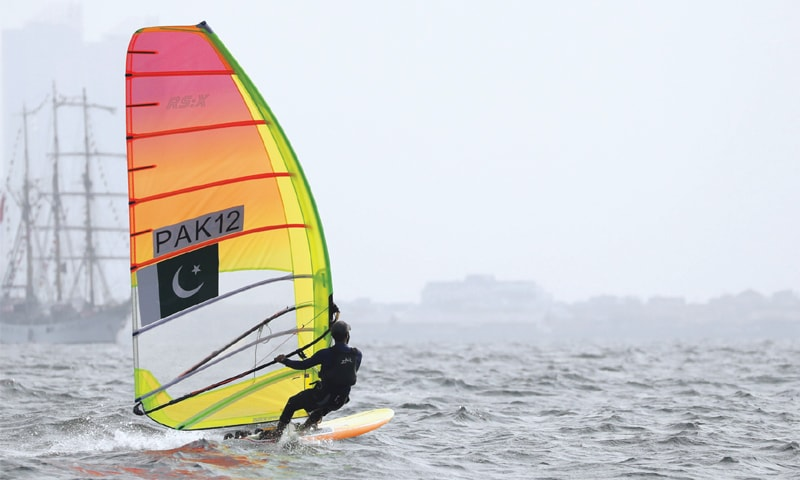 RAJA Qasim Abbas of Pakistan competes in the windsurfing RSX class event on Friday.—Reuters
