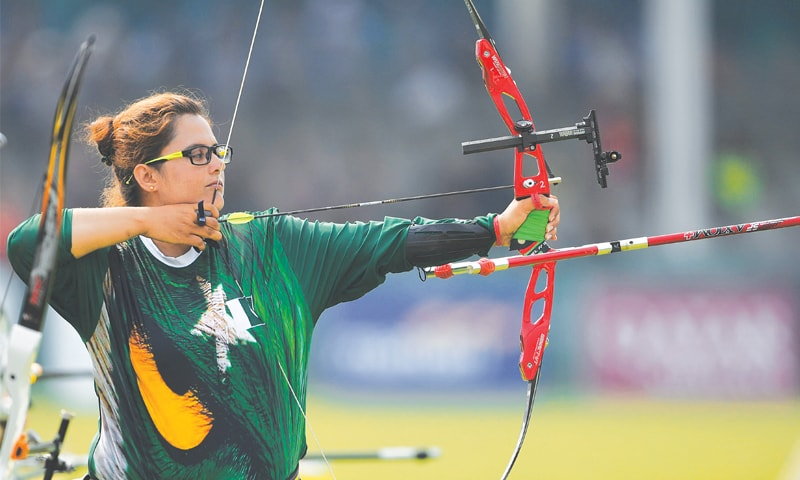 PAKISTAN'S Nabeela Kousar takes part in the recurve mixed team elimination round on Friday.—AFP