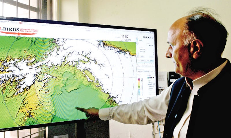 Pakistan Meteorological Department Director-General Dr Ghulam Rasool analyses data obtained from the latest radar system. — Photos by Mohammad Asim