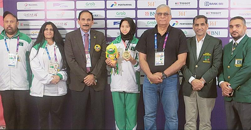 PAKISTAN'S bronze medal winner Nargis (C) is seen with POA president retired Lt Gen Arif Hasan, secretary Khalid Mahmood and chairman Pakistan Karate Federation Mohammad Jahangir on Saturday.