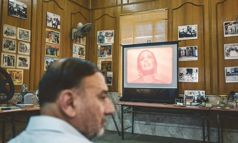 An old Iraqi film is screened during an exhibition of a private antique collection.—The Washington Post
