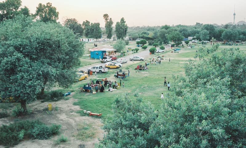 Families gather in a park near the River Tigris.—The Washington Post