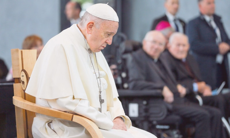 Pope Francis prays at the Knock Shrine, Ireland, on Sunday.—AFP