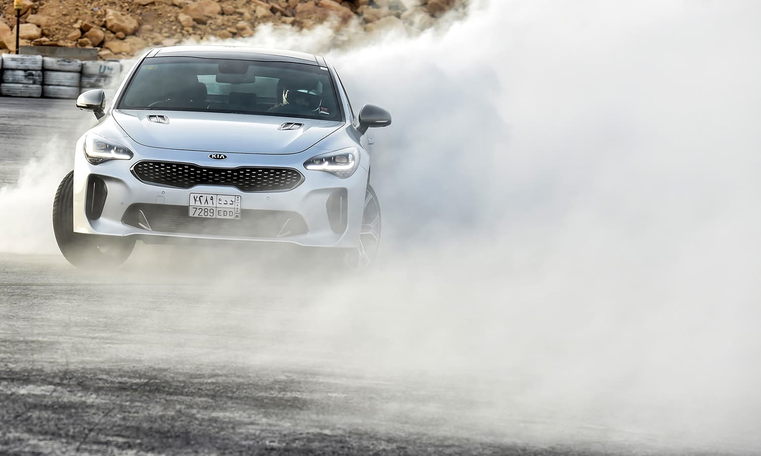 Rana Almimoni, a 30-year-old Saudi motor racing enthusiast, drifts a car on a track in Dirab motor park, on the southern outskirts of the capital Riyadh, on July 19, 2018. — AFP
