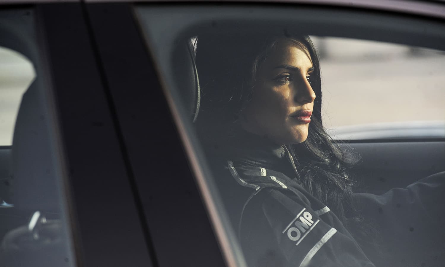 Rana Almimoni sits in her car on a track in Dirab motor park. — AFP