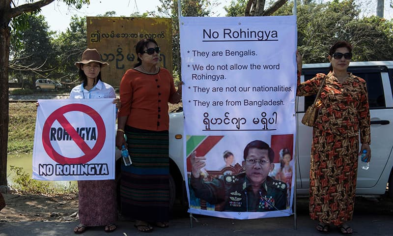 This file photo taken on February 09, 2017 shows supporters of Myanmar Senior General Min Aung Hlaing displaying his portrait during an anti-Rohingya rally by a hardline Buddhist group outside Yangon's Thilawa port as the Malaysian ship carrying relief aid for Rohingya Muslim minority arrives. —AFP