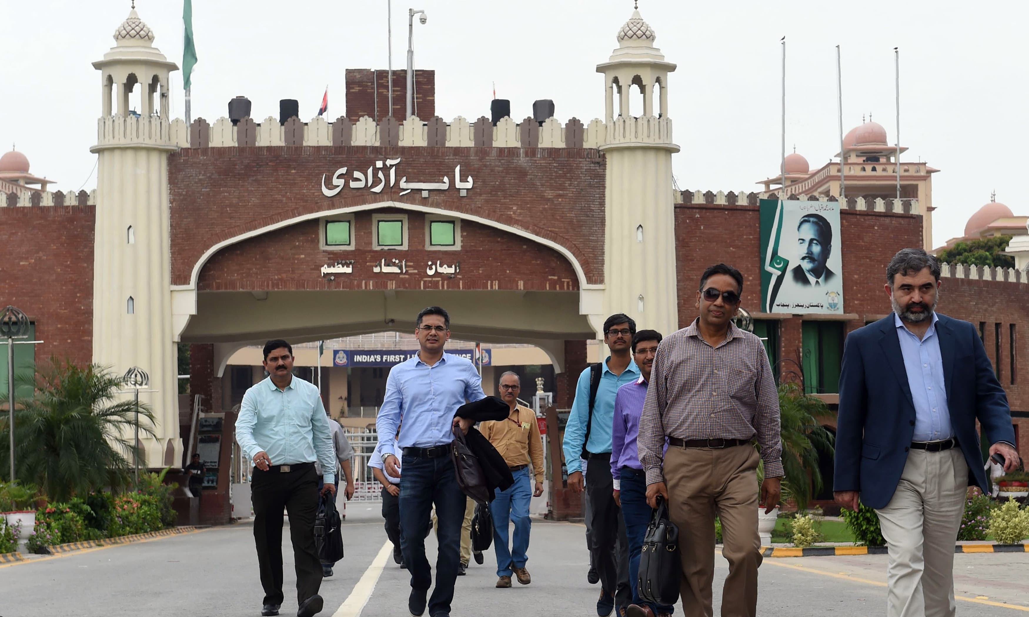 Pakistan's Commissioner for Indus Waters Syed Muhammad Mehar Ali Shah walks with Indian Indus Water Commissioner Pradeep Kumar Saxena on his arrival for a meeting to discuss Indus Waters Treaty and other issues. — AFP