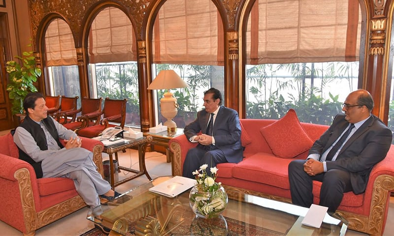 PM Khan chats with NAB chairman. — PM Office