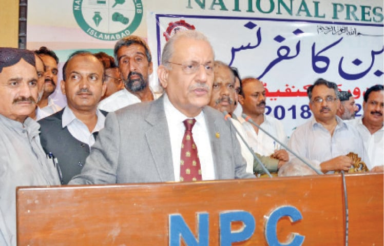 Former Senate chairman Mian Raza Rabbani speaks at the workers conference at the National Press Club on Wednesday. — Online