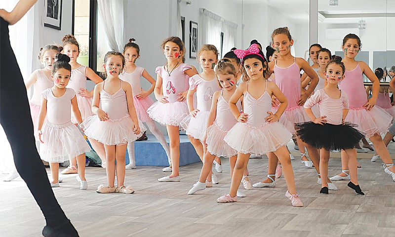 A RUSSIAN dance teacher gives a ballet class to girls in the Russian-Lebanese cultural centre in the city of Aley, east of Beirut.—AFP