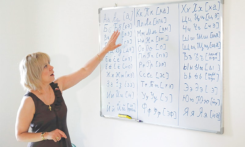 A TEACHER gives a Russian-language class.—AFP