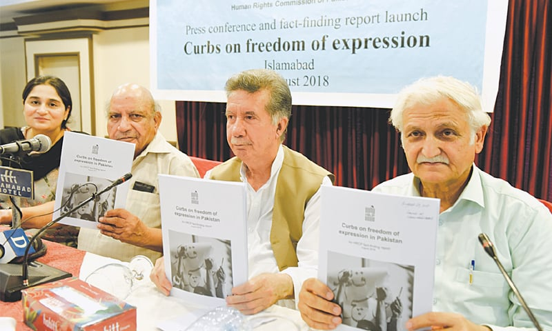 ISLAMABAD: I.A. Rehman, Afrasiab Khattak and Farhatullah Babar show copies of a fact-finding report by the Human Rights Commission of Pakistan on the curbs on freedom of expression during its launch on Wednesday.—White Star