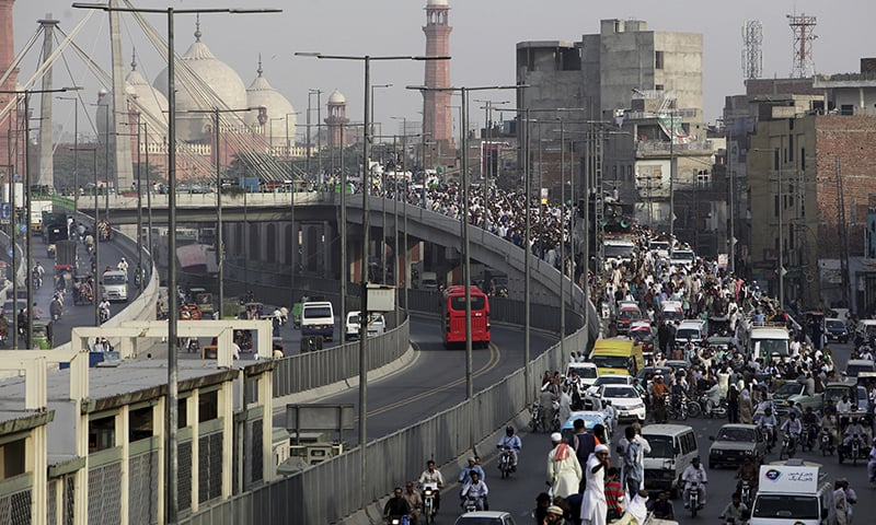 TLP supporters march towards Islamabad from Lahore on Wednesday. — AP