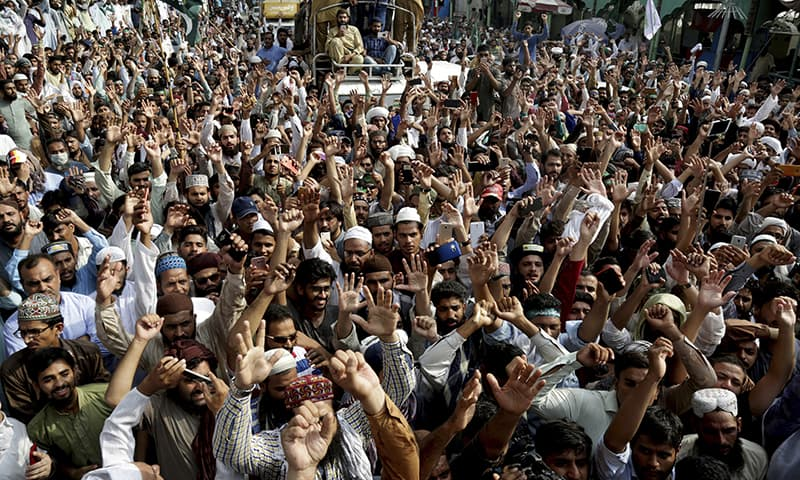 TLP supporters shout slogans during a march towards Islamabad on Wednesday in Lahore. — AP