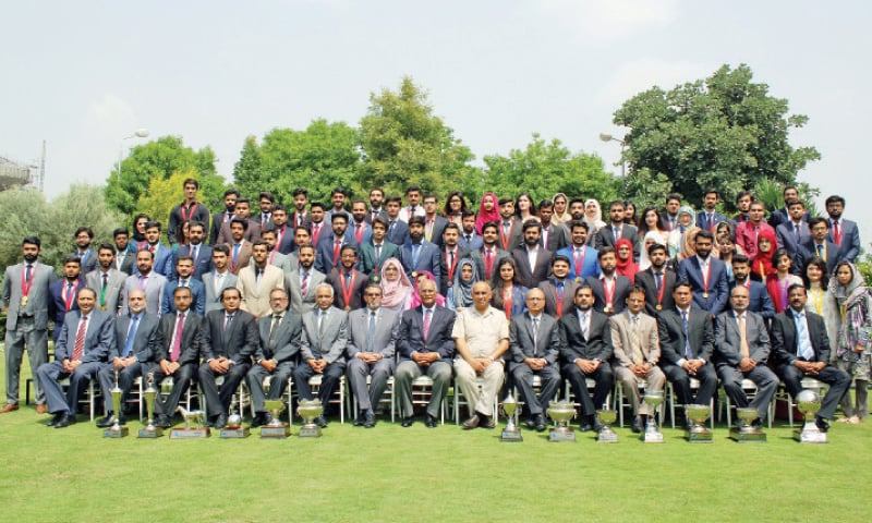 Former Suparco chairman retired Maj Gen Ahmed Bilal poses with the award winners. — Dawn