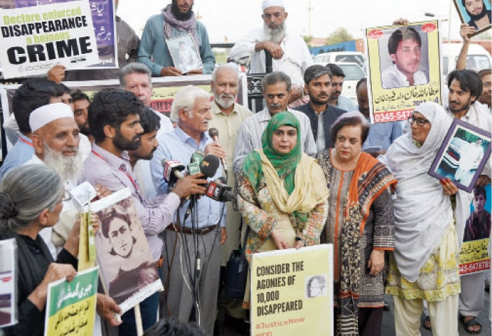 PPP leader Farhatullah Baber addresses participants of the protest against enforced disappearances outside the National Press Club on Thursday.  — White Star