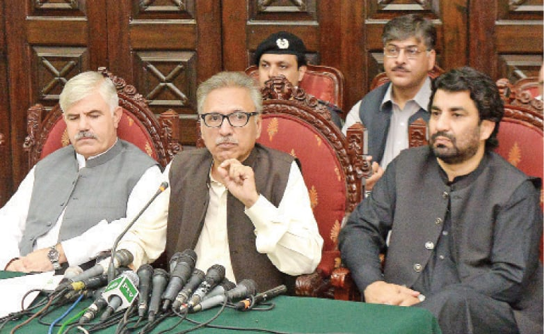 PTI's presidential candidate Arif Alvi addresses a press conference in Peshawar on Thursday. — White Star