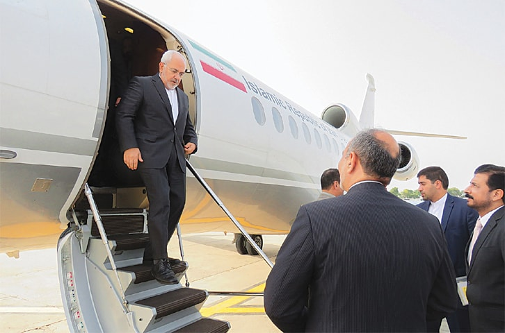 Iranian Foreign Minister Javad Zarif disembarks from his plane at Nur Khan airbase in Rawalpindi on Thursday. During his two-day visit, Mr Zarif will be holding meetings with his Pakistani counterpart and other government leaders.—AFP