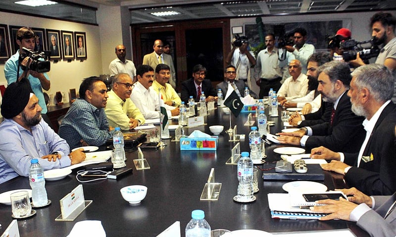 LAHORE: Pakistan's Commissioner for Indus Waters Syed Muhammad Mehar Ali Shah and members of his team talk to Indian Indus Water Commissioner Pradeep Kumar Saxena and other members of his delegation during a meeting on Thursday.—APP