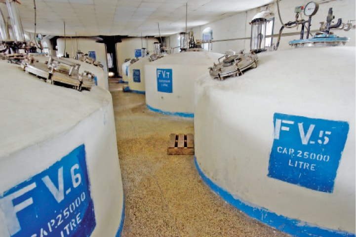 After the barley is boiled, the liquid and waste are separated and the liquid is moved to tanks where sugar is added.