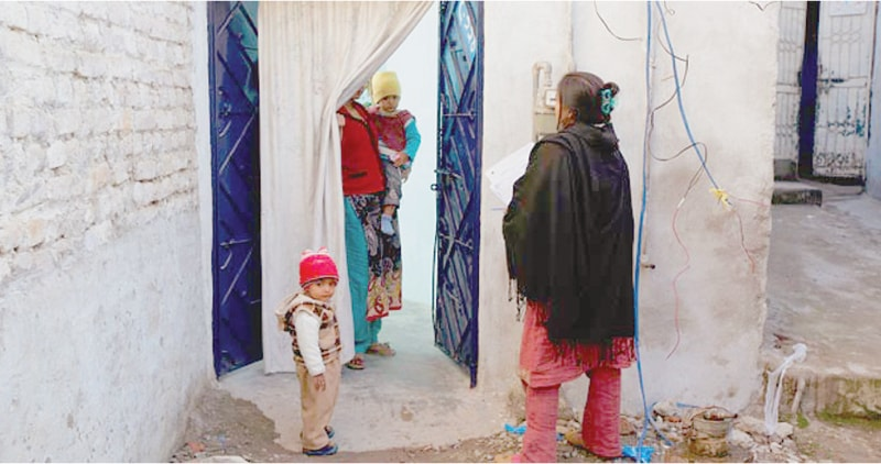 A Lady Health Worker in Islamabad. Zia points out that  they have been active agents of social change in their communities | Dawn File Photo