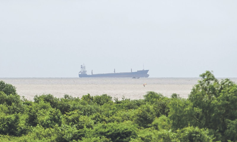 """The abadoned Indonesian ship """"Sam Rataulangi PB1600"""" is seen from the shore of Yangon region on Saturday. A stranded vessel empty of crew and goods that was found in Myanmar's waters this week was being towed by a ship with 13 Indonesian nationals before it became unmoored, the Myanmar Navy said.—AFP"""