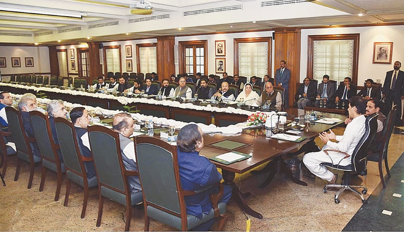 LAHORE: Prime Minister Imran Khan along with Chief Minister Usman Buzdar presides over a meeting of the Punjab cabinet members on Saturday.—APP