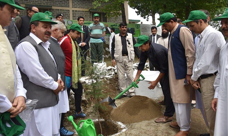 Prime Minister Imran Khan planting a sapling at the launch of '10 Billion Tree Tsunami' at District Haripur. — PTI via Twitter