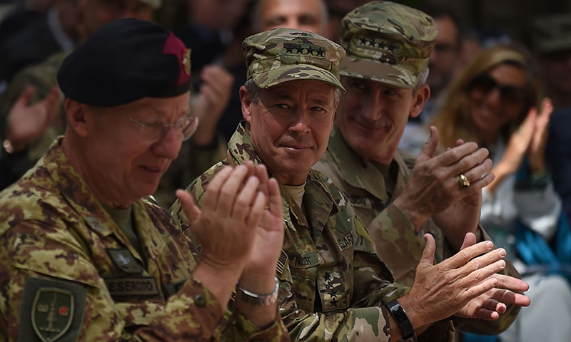General Scott Miller (C), command of US and NATO forces in Afghanistan and outgoing US Army General John Nicholson (R), gesture during a change of command ceremony at Resolute Support in Kabul on September 2, 2018. —AFP
